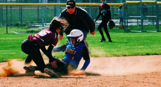 Safe! Varsity second baseman, Nina Gallagher ('19), uses her speed to steal second base.