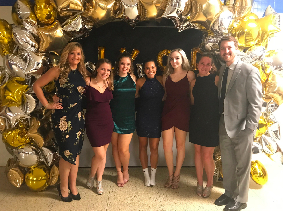 Proudly posing at this year's HoCo dance, the StuCo senior officers smile with their advisers.