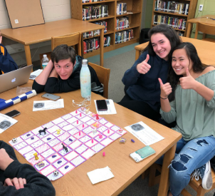 Chess players Austin Ceglowski ('19), Danielle Kucera ('20) and Jenna Clark ('20) cooperate to tackle a hard game of chess on their homemade chess board.
