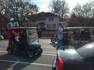 Driving by as part of the Coatesville Christmas Parade, cartoon characters  smile and wave at the spectators lining the streets.