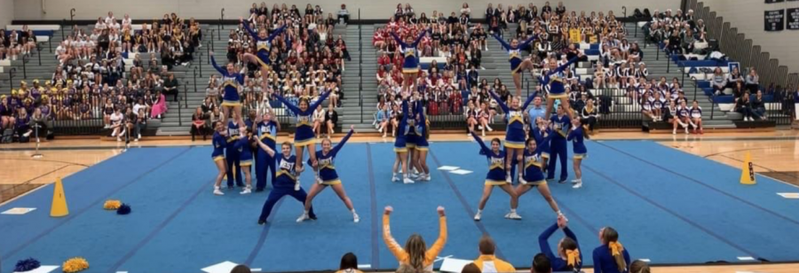Whippets%21+The+West+Cheerleading+team+hits+their+final+pyramid+at+Districts+on+12%2F1%2F18.