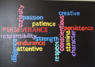 Perfectly painted in a word cloud, this mural, painted by the Mural Club, captures the qualities and traits that students here at West possess.