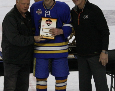 Congratulations! David McQuiston ('19) accepts the Flyers Cup All-Tournament team award from Flyers legends Bob Kelly (left) and Brad Marsh (right).