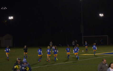 Tonight's the night! The girls of the West varsity soccer team run toward their teammates minutes before their Senior night against Rustin begins.