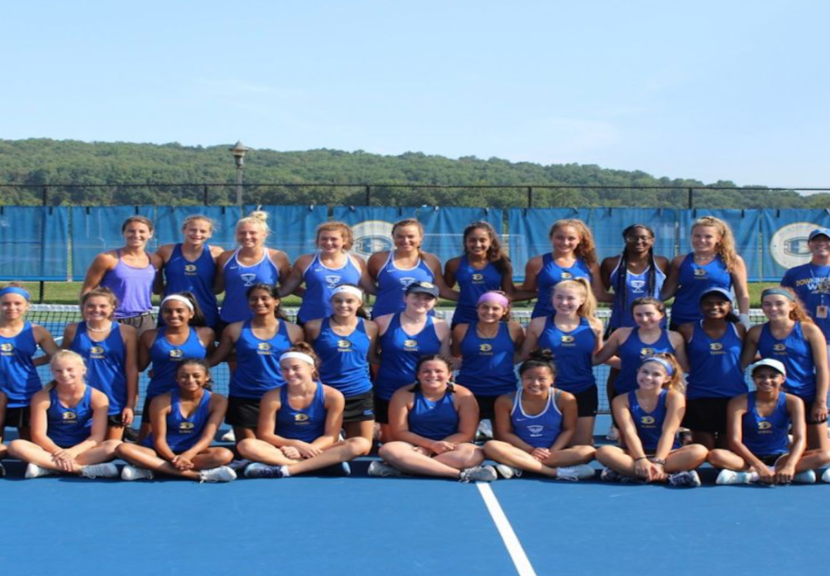 The girls of West's tennis team smile proudly for a team photo.