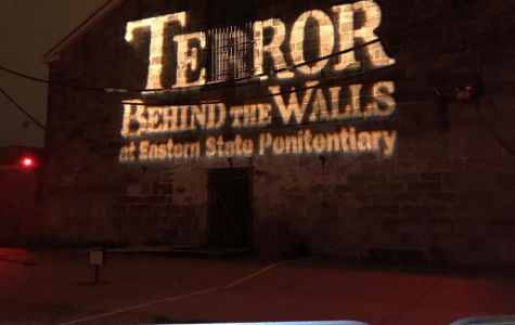 """TERROR BEHIND THE WALLS at Eastern State Penitentiary"" is largely printed on the walls, towering over you as you enter the attraction, preparing you for the horror to come..."