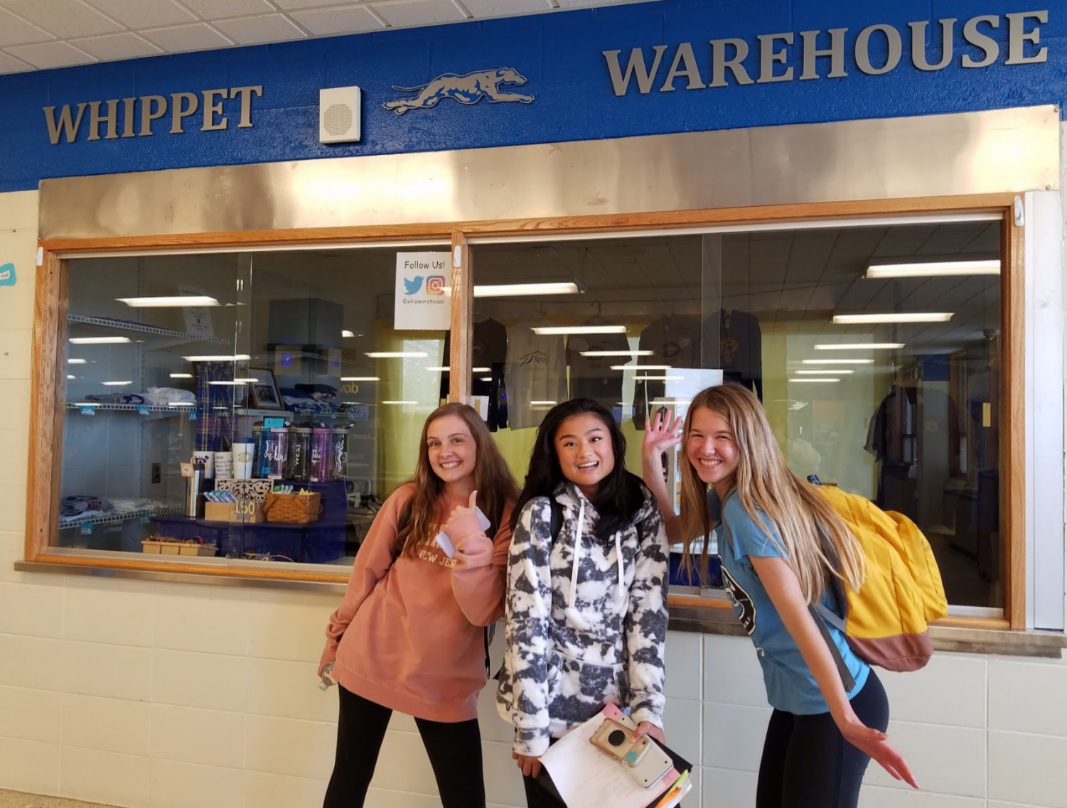 We love The Whippet Warehouse! Juniors Leah McHoul, Rosie Byrne, and Leah Rogelstad strike a pose in front of West's newest business venture.