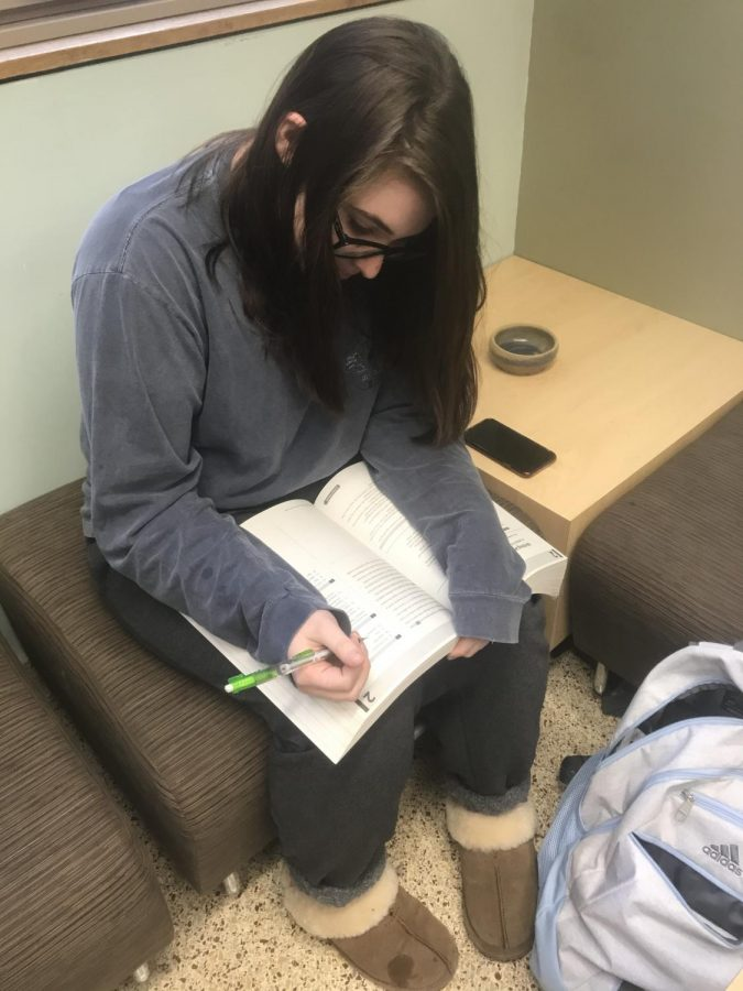 Preparation is key! Madison Roesler (21') prepares for her SAT test in December.
