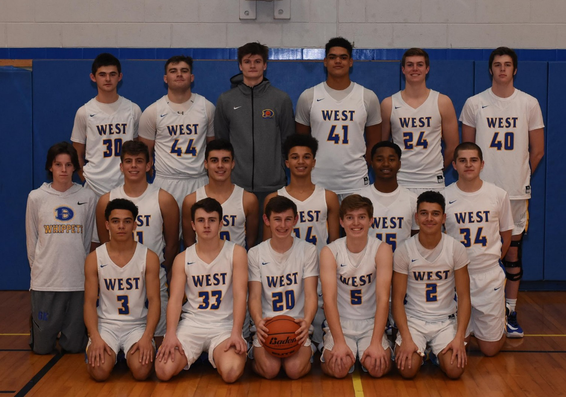 Cheese!! The varsity Downingtown West  Boys' Basketball team poses for team picture.