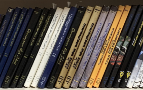A shelf of history! Books dating back to 1979 are lined up in the Publications classroom.