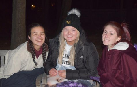 Softball season is here! Natalie Bebee ('20), Hannah Singer ('20), and Emma Eddie ('20) gather at the Unity Day bonfire to keep warm and share stories.