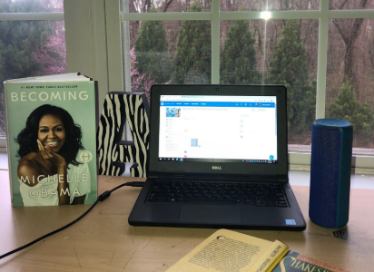 Let's get down to business! Senior Alicia Djomani ('20) surrounds herself with natural light and good literature while she does schoolwork from home.