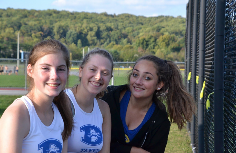 Smile for the Camera! Katelyn Lagore ('23), Stephanie Schoone ('22), and Hannah Davies ('22) smile with joy during their successful tennis match!