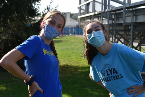 Safety first! Lily Henning ('23) and Julia Marasco ('23) wear their masks and their smiles.