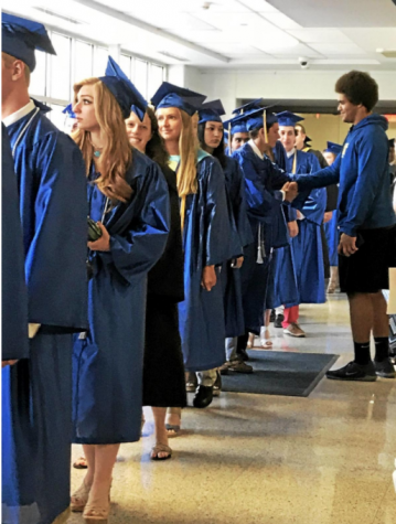 Gathering together for the last time as a group, students from the West Class of 2018 wait to walk to the field for their graduation ceremony.